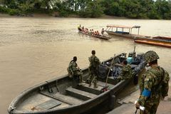 Marines on the river Guaviare Royalty Free Stock Photography