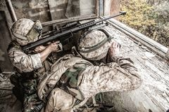 Army sniper team shooting with large caliber rifle stock photography