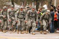 Marines and Soldiers run in full 50 pound packs Royalty Free Stock Images