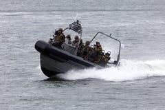Marines speedboat. DEN HELDER, THE NETHERLANDS - JUNE 23: Dutch Marines in a speedboat during an assault demo at the Dutch Navy Days on June 23, 2013 in Den Stock Photo