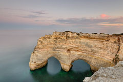 Marinha Beach in Algarve, Portugal at Sunset. Amazing landscape at sunset in the main tourist destination of holidays in Portugal. Beach with arch carved Stock Photos