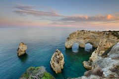 Marinha Beach in Algarve, Portugal at Sunset. Amazing landscape at sunset in the main tourist destination of holidays in Portugal. Beach with arch carved Royalty Free Stock Images