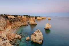 Marinha Beach in Algarve, Portugal at Sunset. Amazing landscape at sunset in the main tourist destination of holidays in Portugal. Beach with arch carved Royalty Free Stock Photos