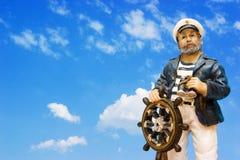Marinheiro no leme Foto de Stock