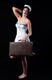 Marinheiro novo com mala de viagem Fotografia de Stock Royalty Free