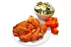Mariniertes, kochfertiges Huhn Stockfoto