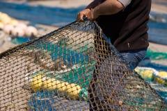 Marins et métiers de pêche photo stock