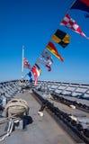 Marinshipbow med nautiska flaggor Arkivbilder