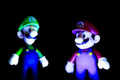 Mario and luigi. Isolated black background Stock Photography