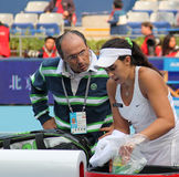 Marion Bartoli (France) and her coach Royalty Free Stock Image