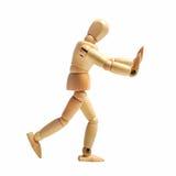 Marioneta de madera que hace publicidad Fotos de archivo libres de regalías
