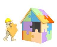 marioneta de trabajo 3d que construye la casa Fotografía de archivo libre de regalías