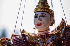 Marioneta en una cadena Imagen de archivo libre de regalías