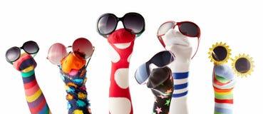 Marionetas del calcetín con los vidrios contra el fondo blanco Imágenes de archivo libres de regalías