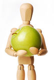 Marionette and Apple. On white background Royalty Free Stock Images