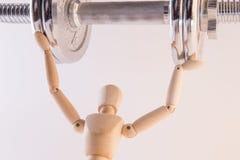 Marionette, die Schwermetallgewicht trägt Lizenzfreies Stockbild