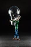 Marionnette avec une ampoule Images stock