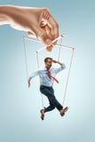 Marionnette d'homme d'affaires sur le fond gris photos libres de droits