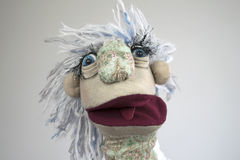 Marionnette de main avec le portrait ouvert de bouche sur le fond blanc Photographie stock