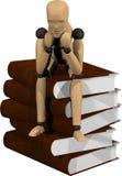 Marionnette en bois avec des livres Photo stock