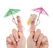 Marionnettes heureuses de doigt de touristes Photographie stock libre de droits