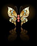 Mariposa del oro con las gemas Fotos de archivo