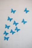 Mariposa del papel azul en la pared Fotografía de archivo libre de regalías