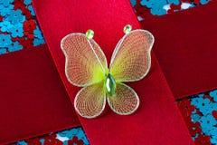 Mariposa en cinta roja Imagen de archivo libre de regalías