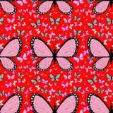 Mariposa rosada grande rodeada por las pequeñas mariposas multicoloras Fotos de archivo libres de regalías