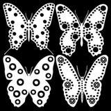 Mariposas blancas en un fondo negro Foto de archivo