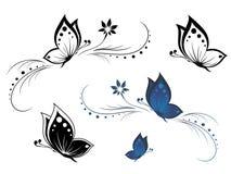 Mariposas con un modelo de flor Fotos de archivo