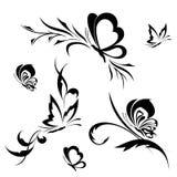 Mariposas con un modelo de flor Imagen de archivo libre de regalías
