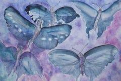 Mariposas de la turquesa en un fondo del liliac Imagen de archivo libre de regalías