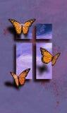 Mariposas de Pascua con la cruz Foto de archivo