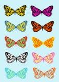 Mariposas multicoloras en un fondo azul Imagenes de archivo