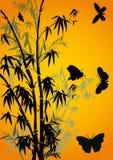 Mariposas y bambú en amarillo Fotos de archivo
