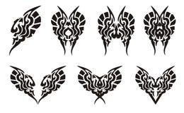 Mariposas y tatuajes tribales de los corazones Imagen de archivo