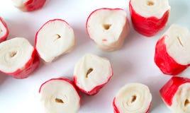 Marisco congelado do surimi no fundo branco imagem de stock royalty free