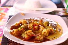 Marisco tailandés oriental del plato en curry Fotos de archivo