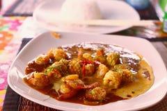 Marisco tailandés oriental del plato en curry Imagenes de archivo