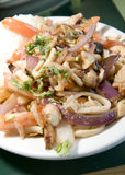Mariscos saltados Peruvian seafood fried in tomatoes onion  fren. Mariscos saltados Peruvian seafood fried in tomatoes and onion with french fries and rice Royalty Free Stock Image
