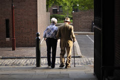 Marital longevity. PHILADELPHIA, PA - APRIL 21, 2012 - An elderly couple walk together as they leave Saturday evening mass at Old Saint Joseph's Catholic Church Stock Images