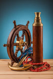 Maritime adventure old anchor and brass  telescope Royalty Free Stock Photography