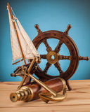 Maritime adventure old anchor and old telescope Royalty Free Stock Image