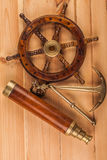 Maritime adventure old anchor and old telescope Stock Photo