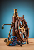 Maritime adventure old anchor and old telescope Royalty Free Stock Photography