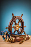 Maritime adventure old anchor wheel  and old telescope Royalty Free Stock Photos