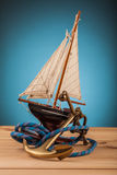 Maritime adventure old anchor and yacht. Maritime adventure marine gadgets on wooden table Royalty Free Stock Photography