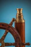 Maritime adventure old wheel and telescope Stock Photo