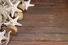 Maritime background with starfish. On old teak wood Royalty Free Stock Images